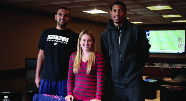 Jared Dudley, Laura Wainman and Otto Porter Jr. in the Verizon Center's Player's Lounge. (Photo by Tony Powell)