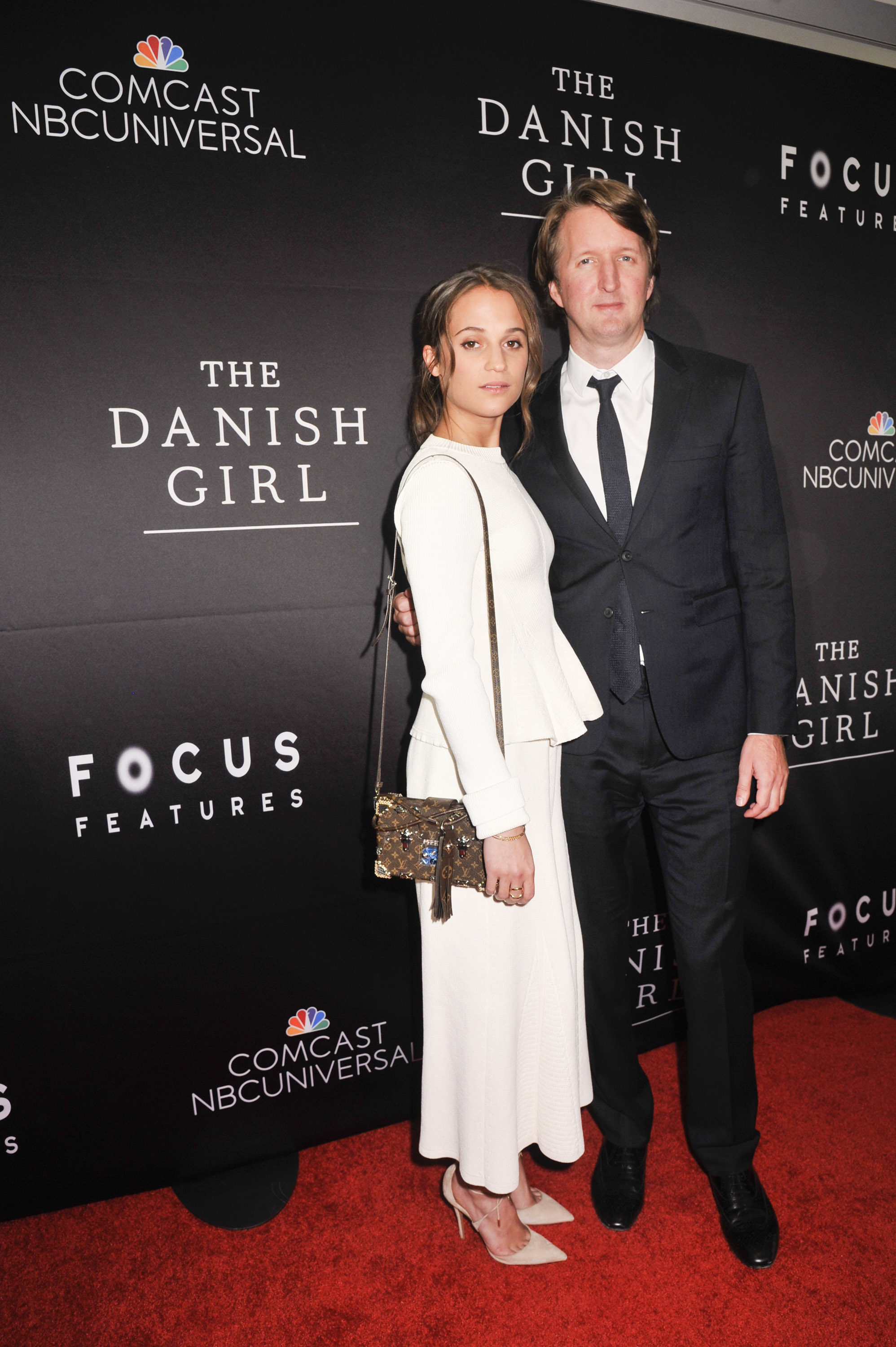 "Alicia Vikander, actress, The Danish Girl; Tom Hooper, director, The Danish Girl, attend the DC premiere of Focus Features' ""THE DANISH GIRL"" at the United States Navy Memorial in Washington DC on November 23, 2015. (Photo by Kris Connor for Focus Features)"