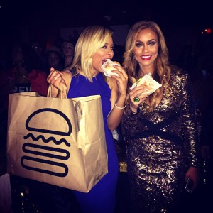 Robyn Dixon and Gizelle Bryant take a bite of Shake Shack at the premiere party at Sax (Photo by Erica Moody)