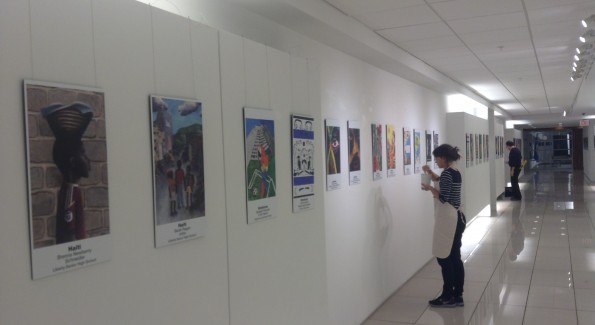 Fabian Goncalves and Jimena Villaseca prepare the exhibition.